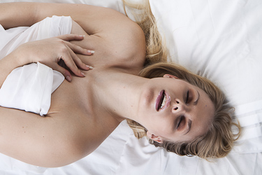 Picture of passionate naked woman on her bed